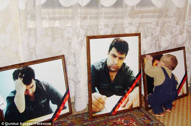 Touching: Gunduz re-imagined a photo of assassinated Azerbaijani journalist Elmar Huseynov's baby son touching a portrait of his dead father