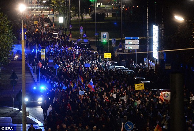 Thousands of anti-immigration protesters protesters marched through the streets of a German city in the latest demonstration against the huge influx of refugees