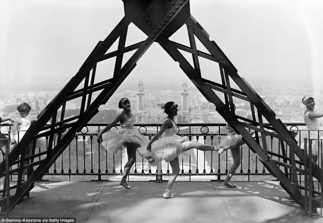 Day trip: Dancers of famous Paris cabaret show at the Moulin Rouge show off their moves on the Eiffel Tower in September 1929