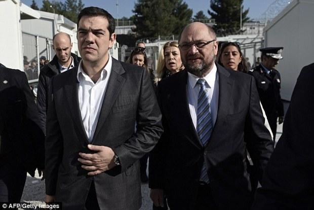 Greek Prime Minister Alexis Tsipras, left, and European parliament President Martin Schulz visit the Moria Hot Spot in Mytilene, Lesbos on Thursday
