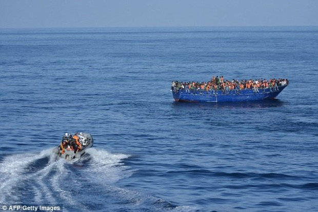Rescued: The 517-strong group, which included two babies, had packed onto a 66ft-long fishing boat in an attempt to cross the Mediterranean from Libya