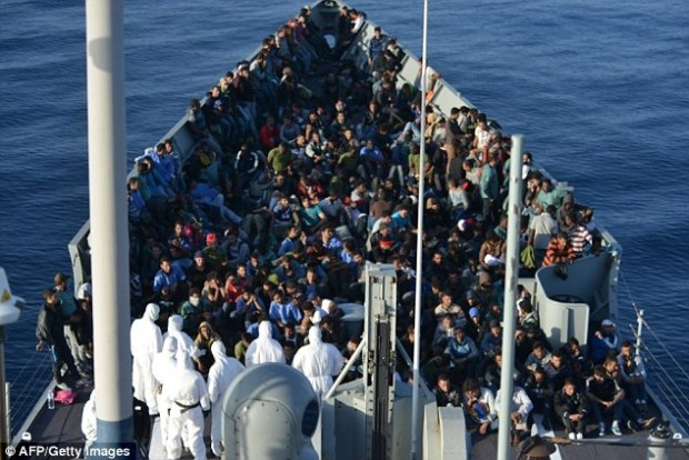 """The refugees and migrants rescued off the coast of Libya gathered on the """"Canarias"""" frigate which then headed to the Italian port of Lampedusa"""