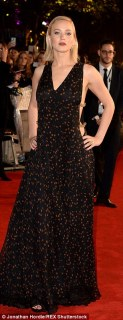 Give us a twirl! The 25-year-old actress, who plays heroine Katniss Everdeen in the franchise, ensured onlookers got a look at her cleavage-baring dress from all angles