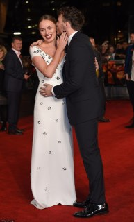 Sealed with a kiss: Sam couldn't keep his hands off his gorgeous wife, who he wed in 2013
