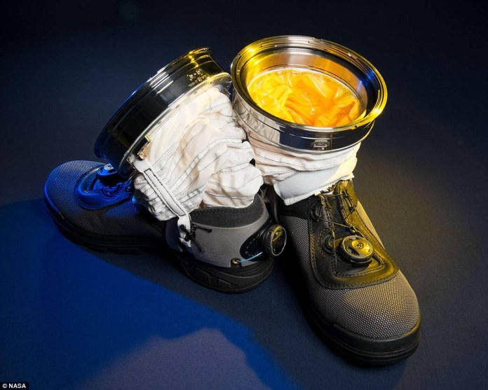 'The Z-2 suit is a technology demonstrator for a planetary surface suit - and has adjustable boots opened by a clasp rather that heavy 'moon boots'