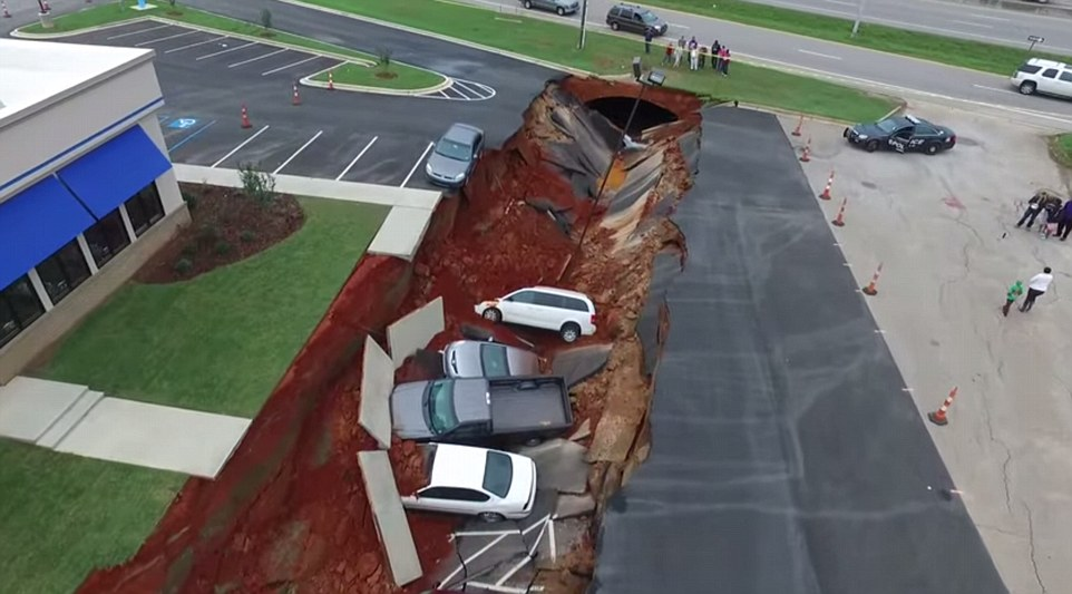 Around 15 cars which were parked behind the restaurant fell into the chasm, while one had a lucky escape and can be seen teetering on the edge