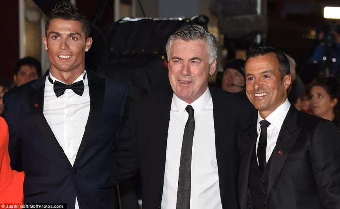 Ronaldo (left) stands alongside his former Real Madrid manager Carlo Ancelotti (centre) and agent Jorge Mendes (right)