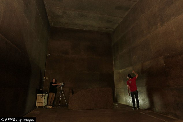 The Great Pyramid contains the most elaborate system of passages and chambers within any pyramid. Two chambers have been found, including the King's Chamber (pictured) but no body was found in the sarcophagus. Here, researchers use infrared thermography to map the walls of the chamber