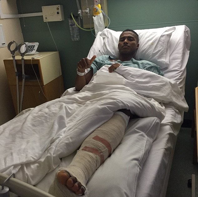 Antonio Valencia gives the thumbs up from his hospital bed after undergoing an operation on his foot
