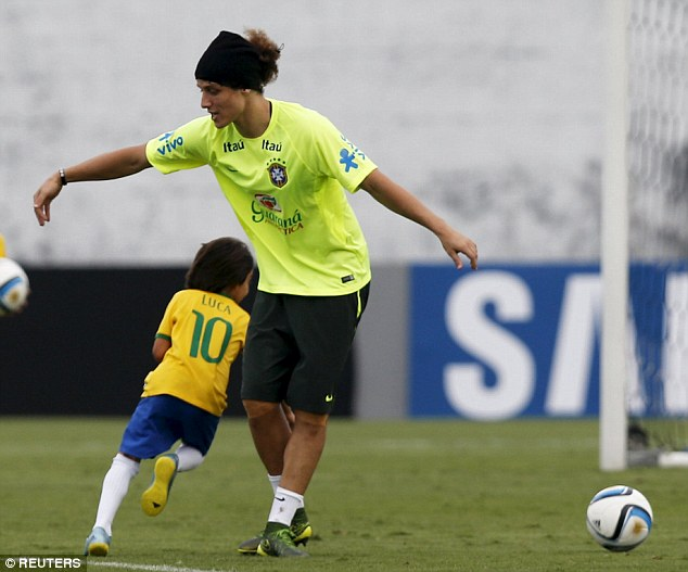 Kaka's seven-year-old son, Luca, was sidestepping David Luiz in Brazil's practice prior to Argentina
