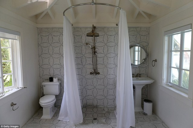 The bathroom is seen in the pool cabana of the giant estate