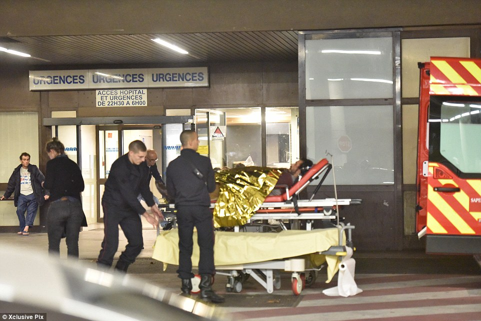 At least 35 people are thought to have been killed inside the Bataclan concert hall and several people were wounded (pictured)