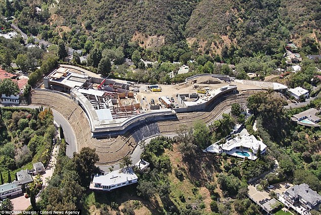 The 100,000-square-foot home, which is still being built (pictured) is close to several celebrities' houses