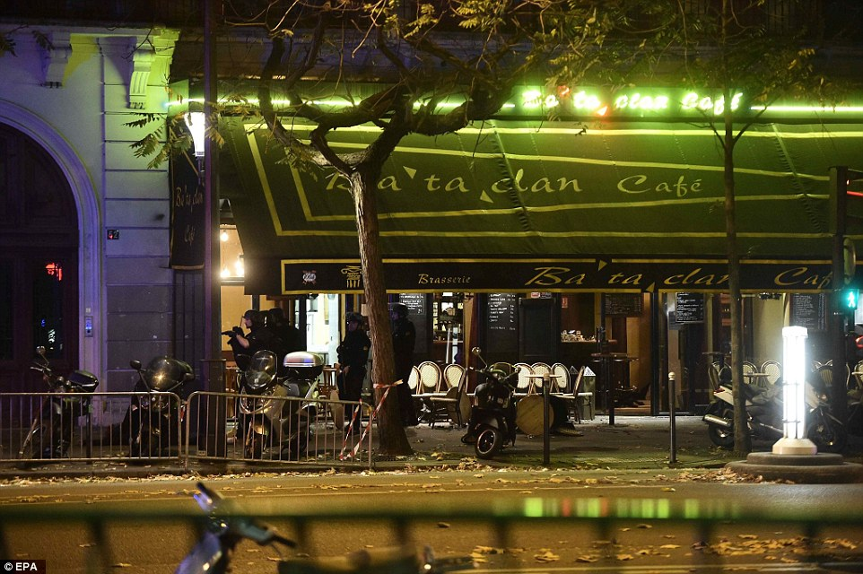 Tension: Armed police prepare their assault on the terrorists at the Bataclan concert hall, where more than 80 people were slaughtered