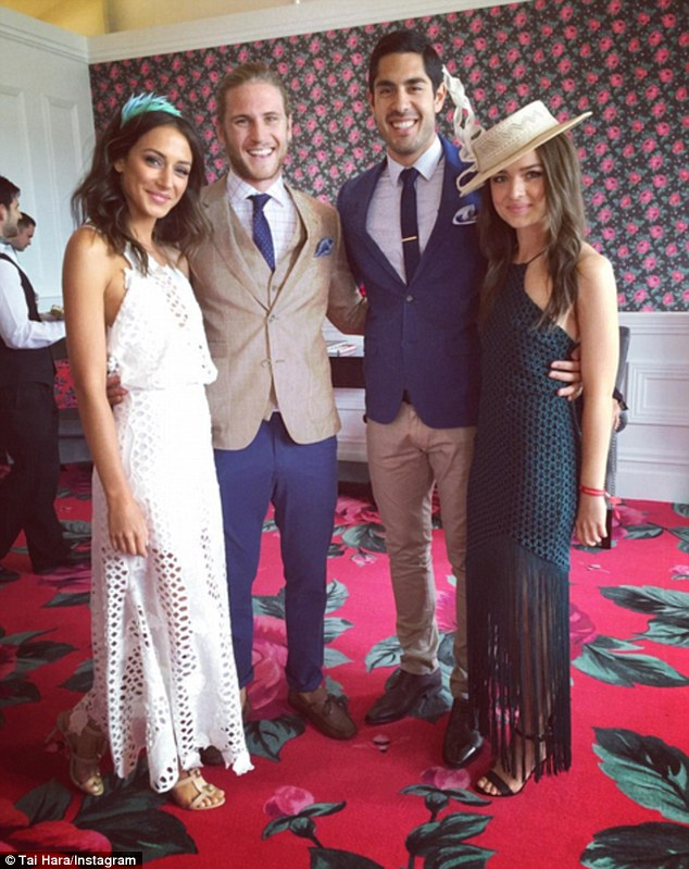 Three's company, four's a crowd: The friends bunched in for snap onStakes Day in Melbourne