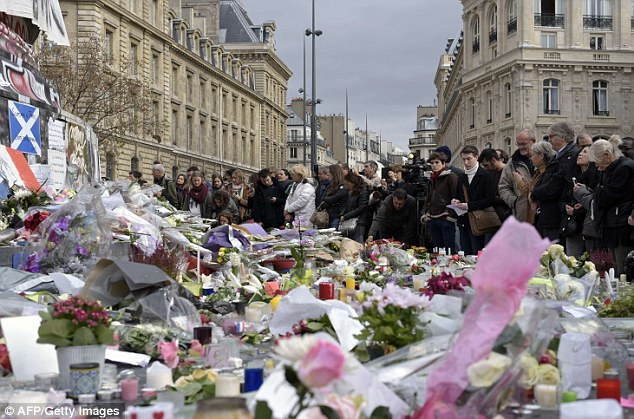 Sadness: In the wake of the Paris attacks, being mourned by the entire country, some have said the Muslim community has not been strong enough in its condemnation of fanatics in the past
