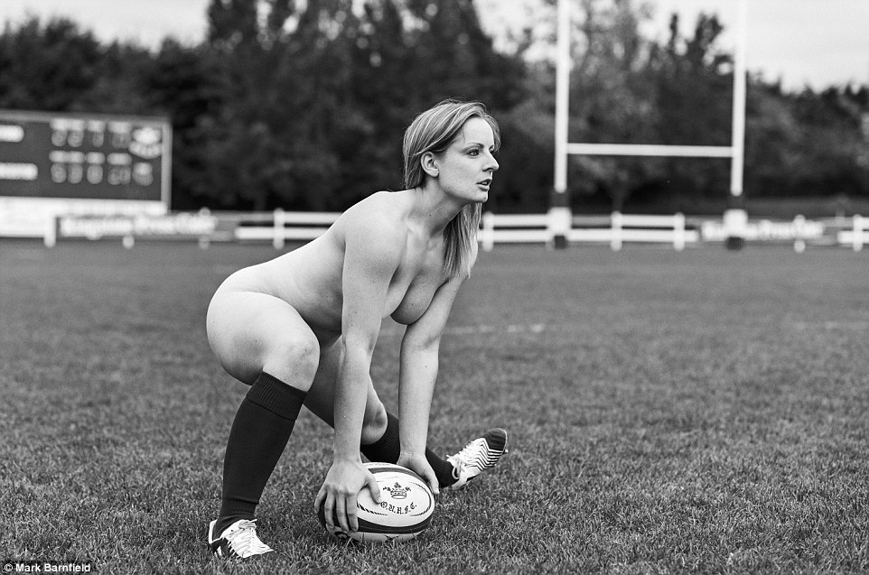 An Oxford University scrum half prepares to pass the ball, in one of the shots for the team's 2016 naked calendar