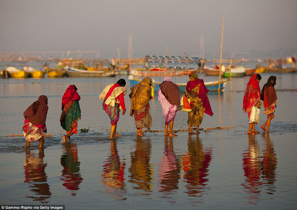 In Allahabad, north India, take a dip in the Ganges while wearing saris. Hindus bathe in the Ganges to cleanse themselves of their sins