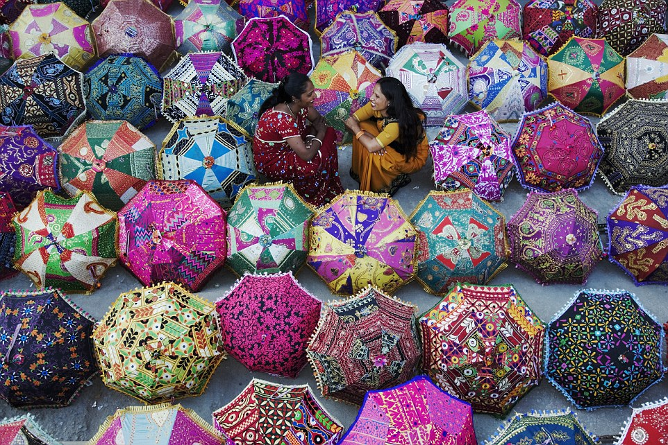 Colourful umbrellas (above) are set outside a shop in Jaipur, north India, allowing shoppers to easily admire the products and browse