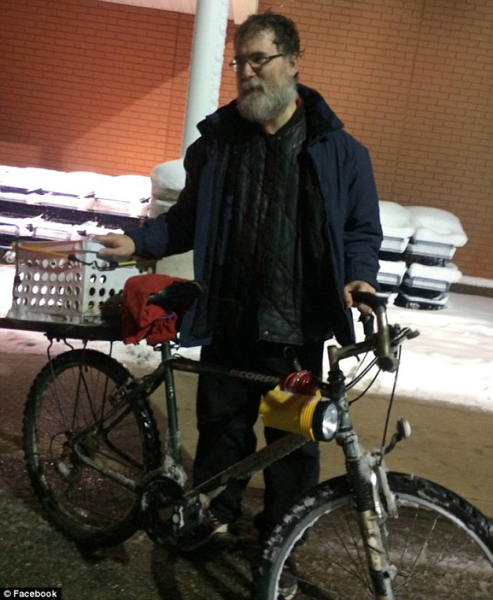 Difficult time:Tony Berard (above) of Waterford, Michigan rides his bike 14 miles every day to and from work to save money for his ill wife and pay for her caretaker