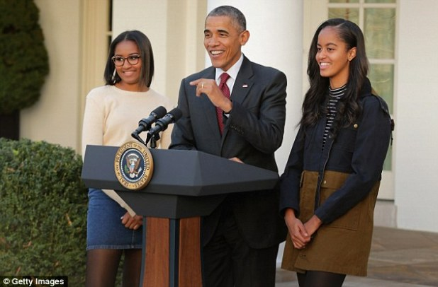 Sasha Obama (left) was wearing dark tortoise shell-rimmed glasses, the first time she has been seen in public with them. Malia Obama (right) giggled and smiled through today's turkey pardoning ceremony, after their demeanor at last year's event, and subsequent criticism, led to a GOP aide stepping down