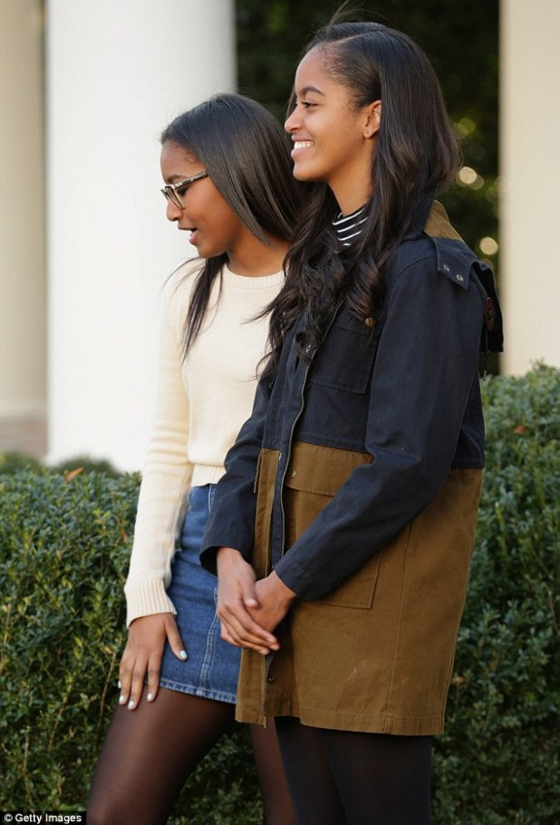 All grown up: Sasha (left) and Malia (right) once again accompanied their father to the White House Rose Garden and stood by his side during the annual turkey pardon, a White House tradition