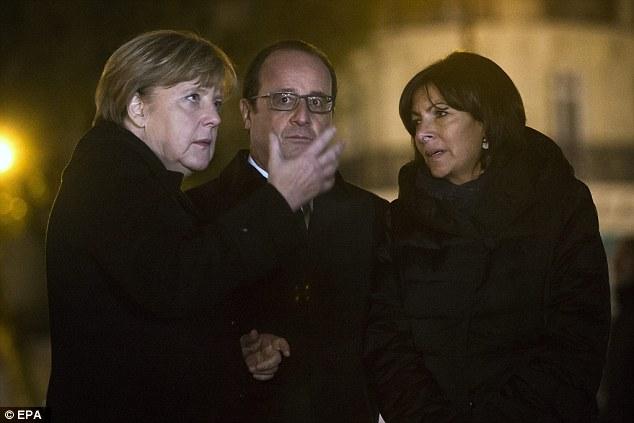 Paris Mayor Anne Hidalgo (right) also attended the memorial at the Place de la Republic in Paris