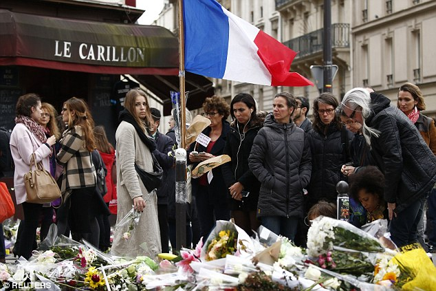 President Francois Hollande has called for people to hang Tricolour flags outside their homes on Friday as a service of hommage takes place at Les Invalides in the capital city