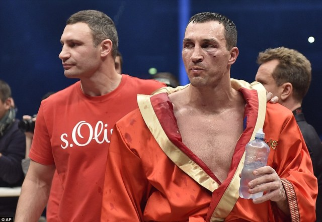 Klitschko swigged from a bottle of  water as he awaited his fate alongside his 44-year-old brother Vitali (left)