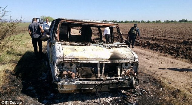 Mexican news outlets have reported finding a burnt Chevy on the side of a road with two bodies inside