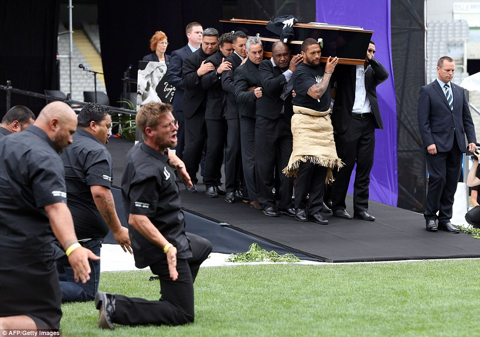 Lomu's coffin is carried onto the pitch by 12 pallbearers as former players begin their haka in his honour