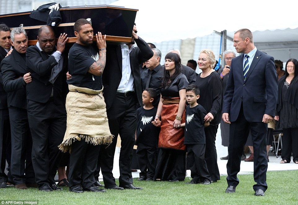 Lomu's coffin is carried away from Eden Park, where a public memorial was held earlier