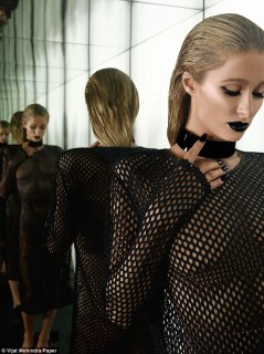 Sci-fi inspired? In another shot Paris is wearing a see through mesh dress, which exposes her chest. A pair of nude pants preserve her modesty