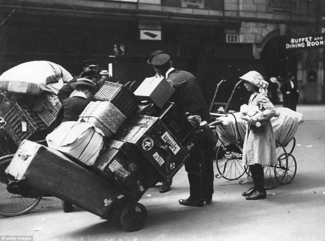 Porters helping holidaymakers with their luggage at Waterloo Station, London, in 1913, just a year before the start of World War One