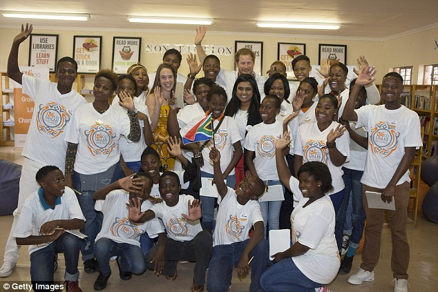 The down-to-earth royal posed for a group shot with young people who aretaking part in the Nelson Mandela – The Champion Within programme