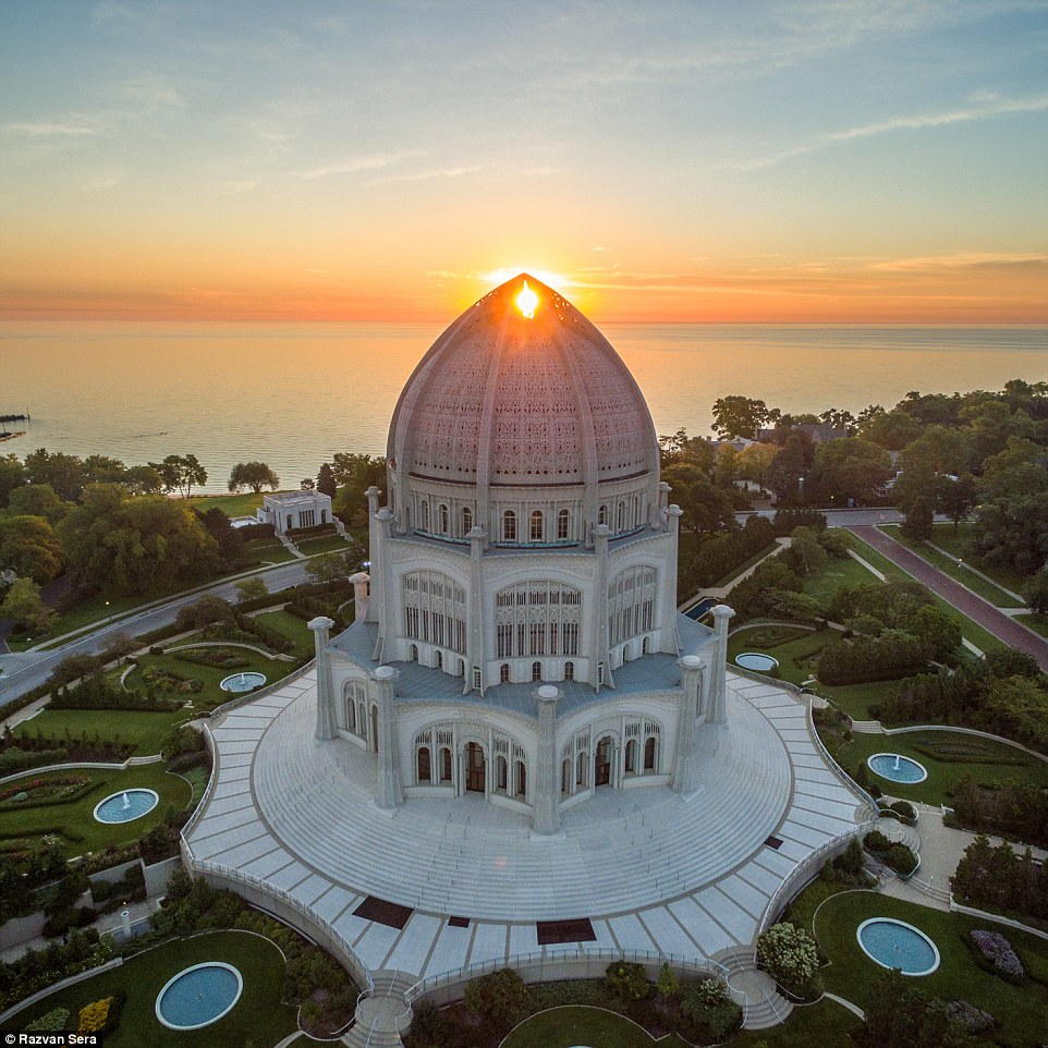 User @razdood perfectly captured the Bahá'í House of Worship in Wilmette, Illinois with an orangey sun peeking through the top