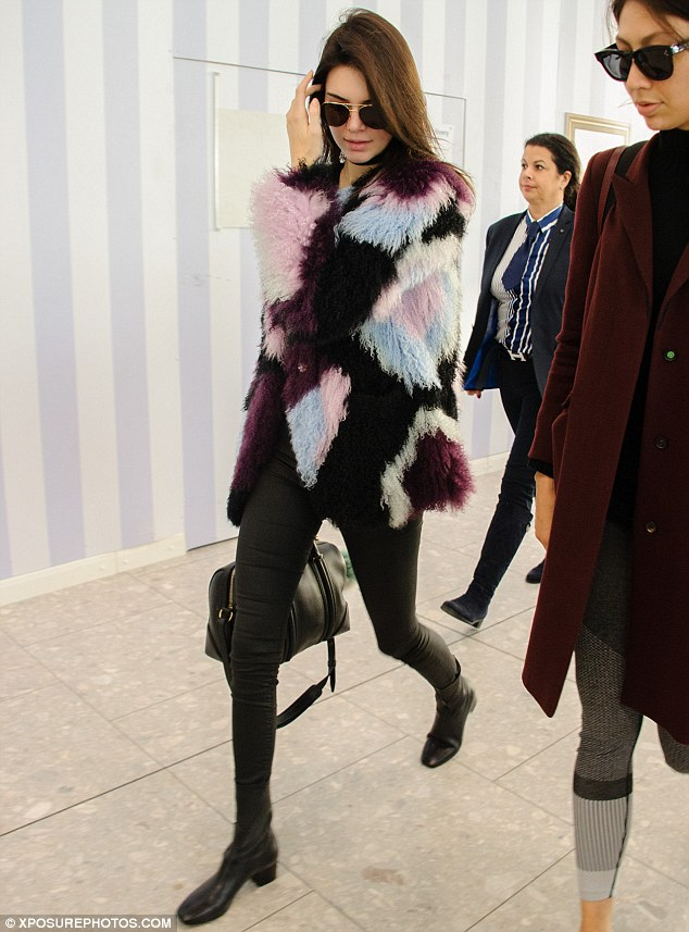 Absent aunt: It appeared that Kendall Jenner's quick stop in London as over, as the model prepared to catch a flight back to Los Angeles on Tuesday - presumably to meet nephew Saint for the first time