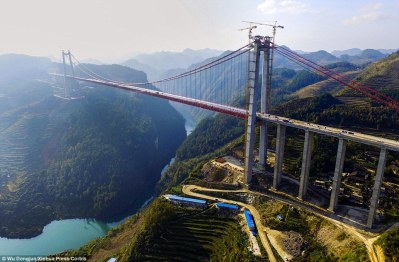 Impressive: It has been built in rocky terrain to improve transport links between the provincial capital of Guiyang and other counties