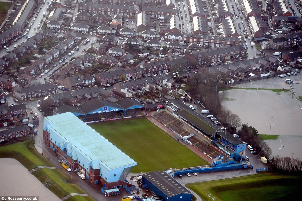 These aerial photos show how Carlisle United Football Club's ground has finally dried out after being besieged by waist-high floodwater