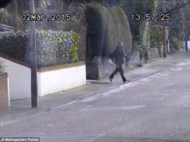 Video footage shows another member of the gang, Achmed Abdulaziz Ahmed, going to the address of a victim in Dorset and then leaving with a package of money - the victim believed him to be a police officer