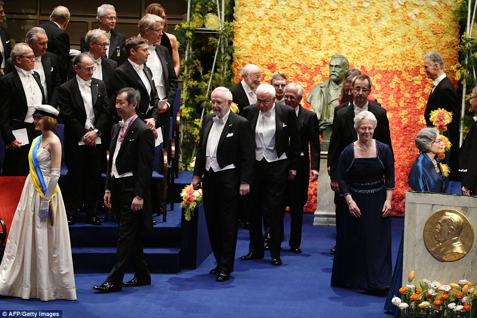 Nobel Physics Prize 2015 co-winners Japanese Takaaki Kajita (second left) and Canadian Arthur B McDonald (third left), Nobel Chemistry Prize 2015 co-winners Sweden's Tomas Lindahl (fourth left), US Paul Modrich (fifth left), Turkish-American Aziz Sancar (sixth left) arrive among others for the 2015 Nobel prize award ceremony at the Stockholm Concert Hall on December 10, 2015. The Prize ceremony for the