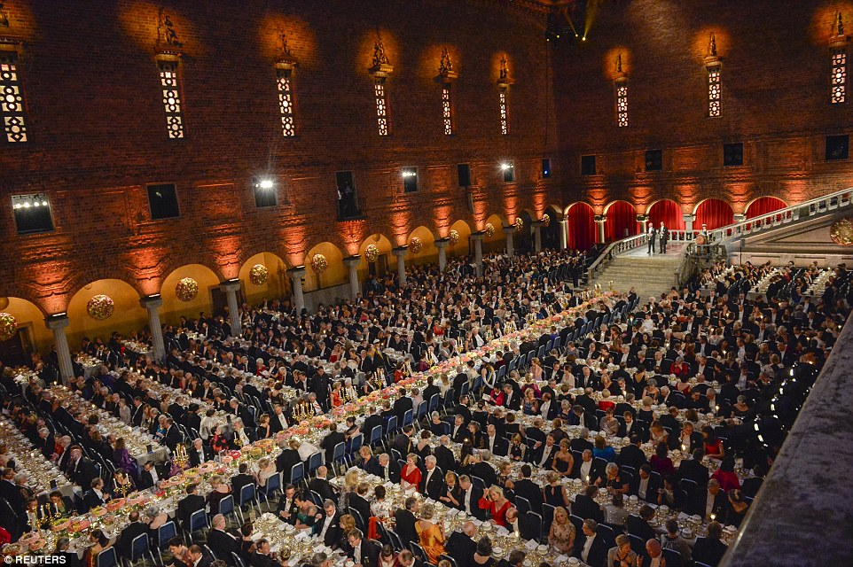 The vast hall was bisected by the immense top table, with other guests on tables situated in rows to along the sides