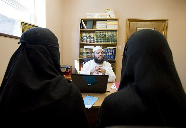 Two women Muslim women apply for a divorce in front the Sharia Court judge Sheikh Haitham Al Haddad