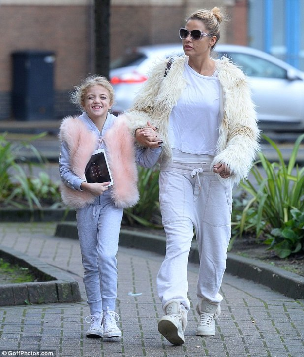 Turning heads: The mother and daughter duo arrived at the New Victoria Theatre in very similar outfits, both sporting white tracksuits and stylish fur jackets