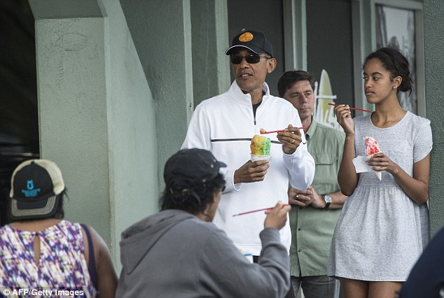 Let the chill begin: Barack Obama has come under fire again for the cost of his Christmas vacation. The Commander-in-Chief is pictured above enjoying a shaved ice with Malia Obama at the end of last year's holiday
