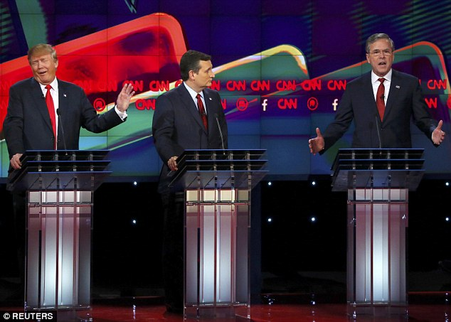 Jeb Bush (right, with Trump left) joined in attacks on Trump's proposal at the Republican debate in Las Vegas yesterday, saying it was 'not serious' and accusing him of being a 'chaos candidate'