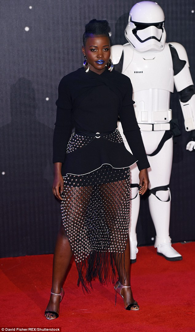 Futuristic fashion: Lupita Nyong'o stole the show at theStar Wars: The Force Awakens film premiere in London's Leicester Square on Wednesday night