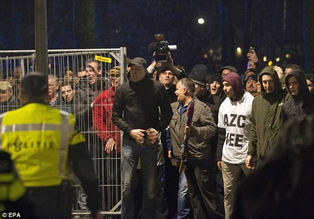 Running skirmishes between youths (pictured) and the police went on until the early hours of Thursday morning