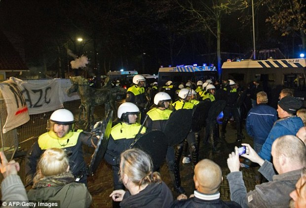 The mob, who left the town hall looking like a 'battlefield', yelled 'no n****** here!' and 'foreign scum keep away!'