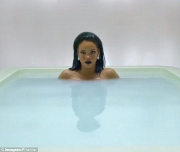 Not shy: The naked chart-topper is lucky to have her modesty preserved by cloudy water, which strategically rests above her cleavage